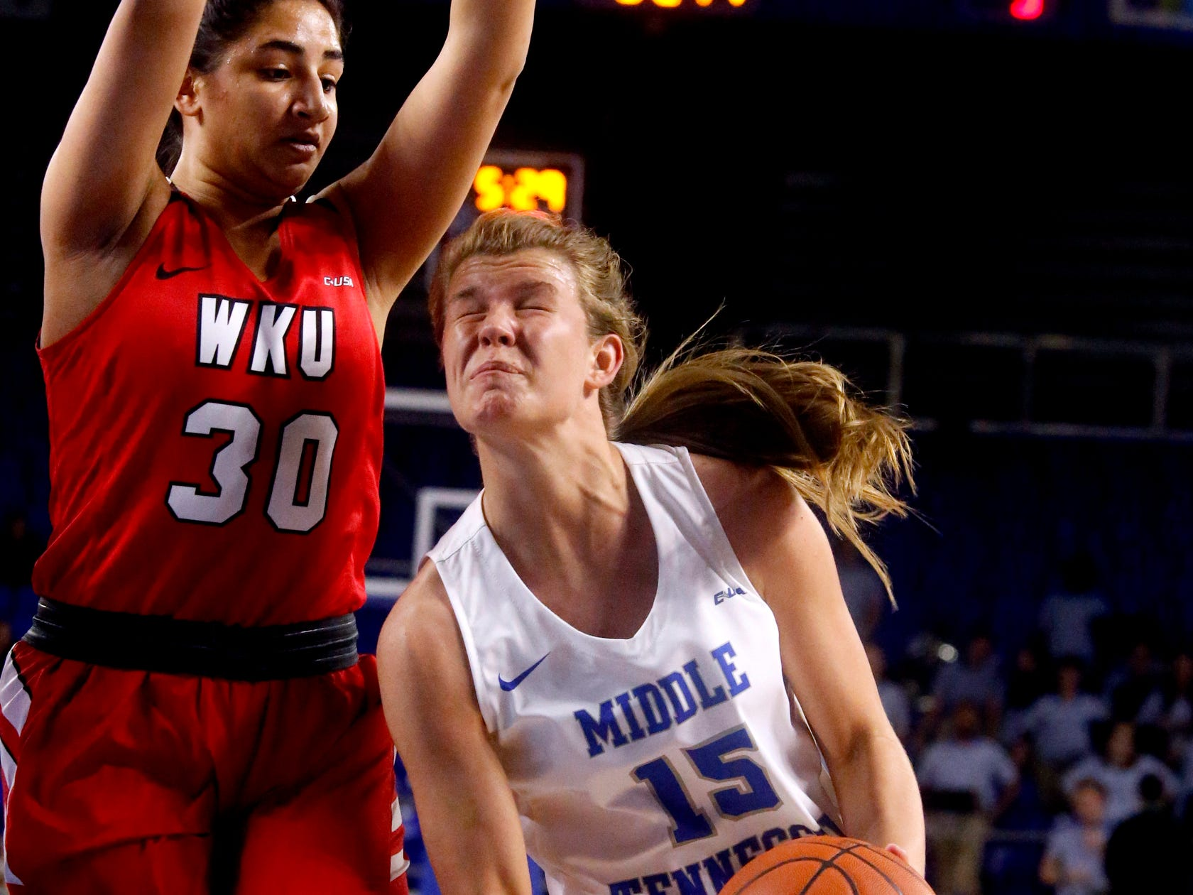 MTSU's guard Anna Jones (15) goes up for a shot as Western's guard Meral Abdelgawad (30) guards her on Thursday, Feb. 14, 2019.