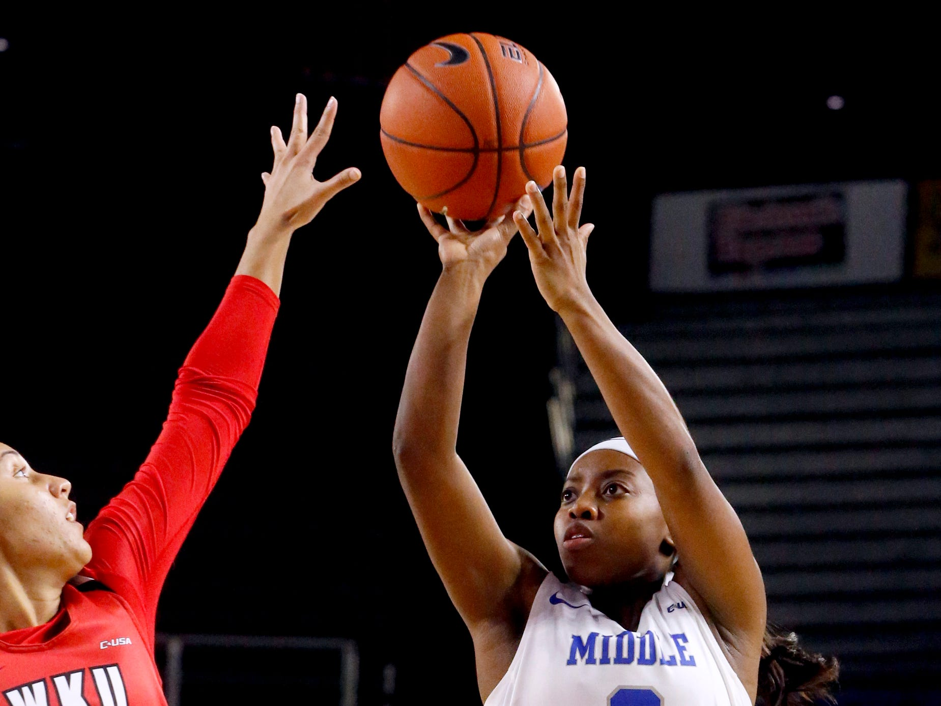 MTSU's guard Taylor Sutton (2) shoots the ball as Western's guard Alexis Brewer (11) guards her on Thursday, Feb. 14, 2019.