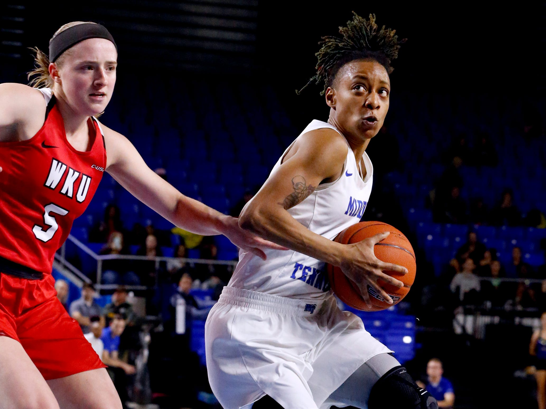 MTSU's guard A'Queen Hayes (1) goes up for a shot as Western's guard Whitney Creech (5) guards her on Thursday, Feb. 14, 2019.