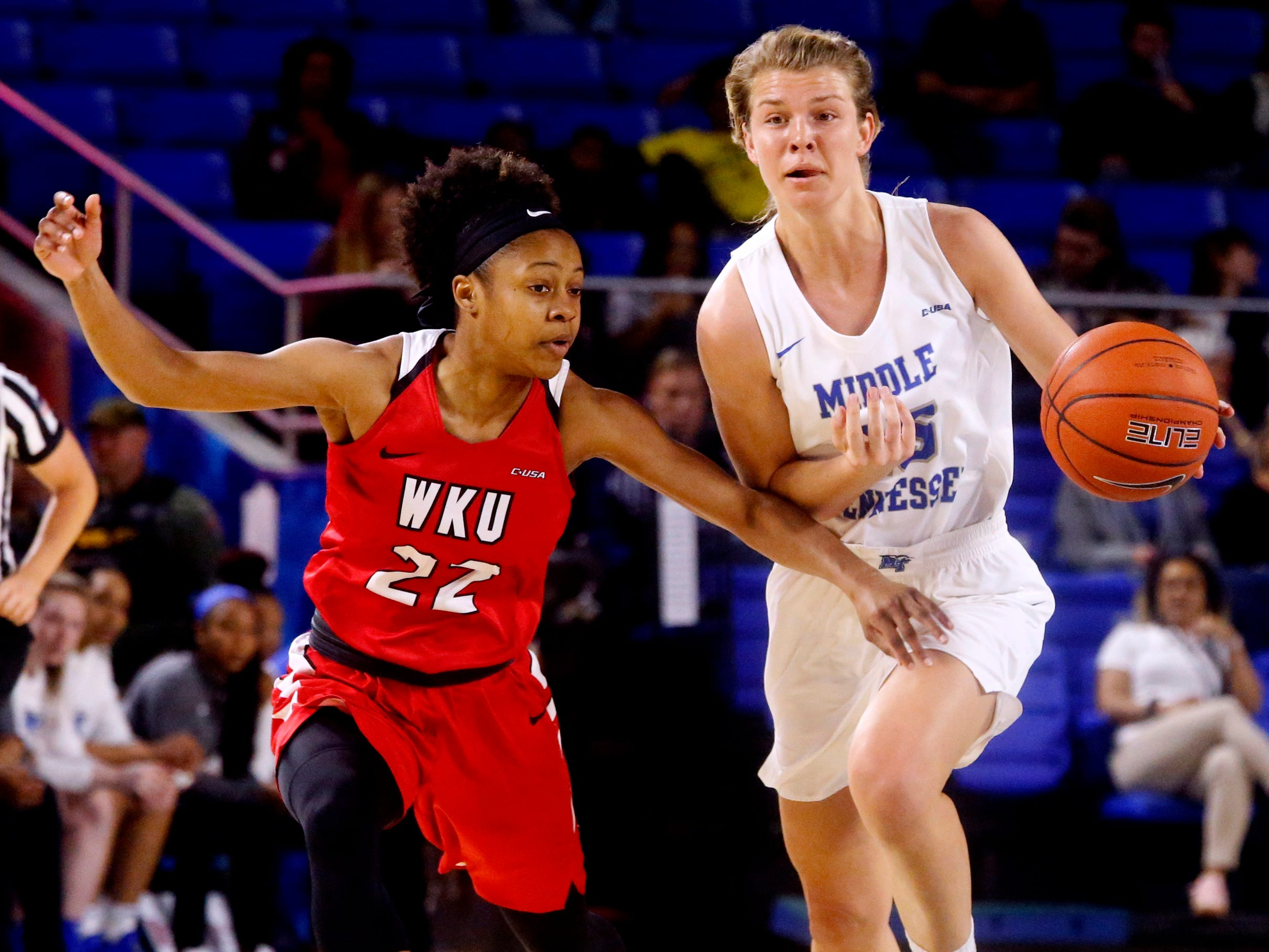 MTSU's guard Anna Jones (15) brings the ball up court as Western's guard Sherry Porter (22) guards her on Thursday, Feb. 14, 2019.