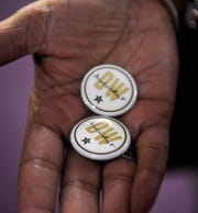 David Williams memorial buttons were given out during visitation before the funeral for former Vanderbilt athletics director David WIlliams Friday, Feb. 15, 2019, at The Temple Church in Nashville, Tenn.