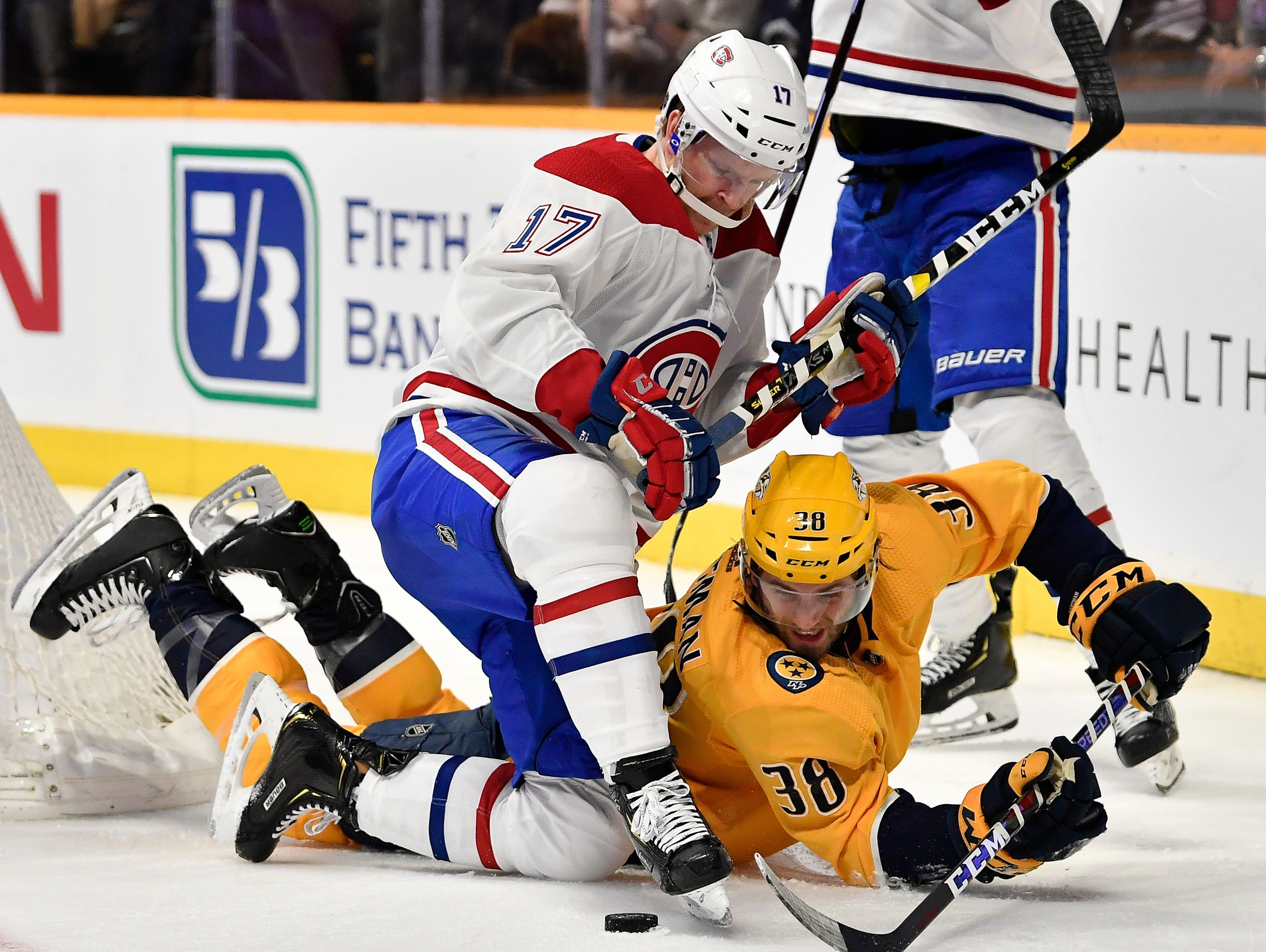 Predators right wing Ryan Hartman (38) battles for the puck with Canadiens defenseman Brett Kulak (17) during the third period at Bridgestone Arena Thursday, Feb. 14, 2019 in Nashville, Tenn.