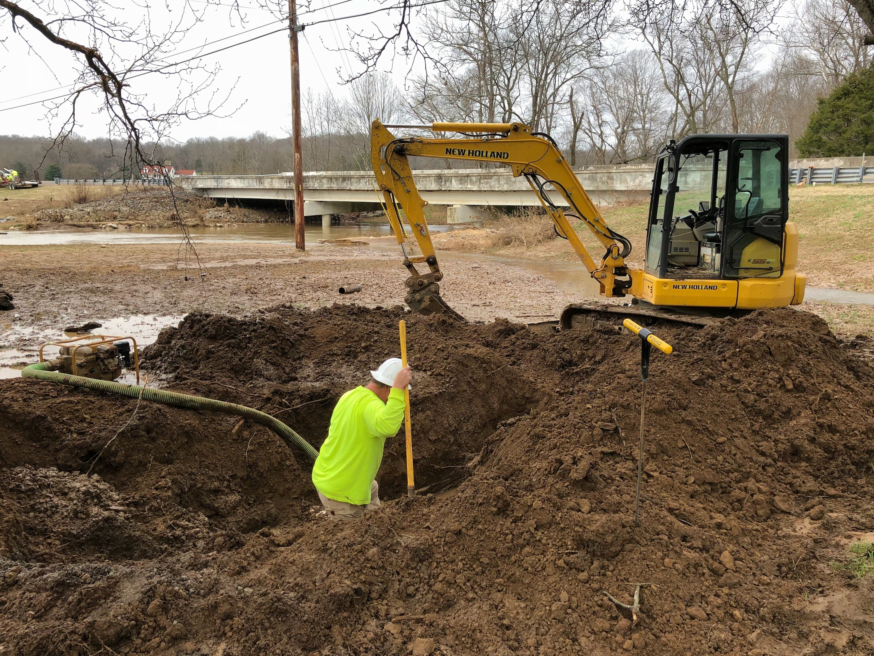 Water Authority of Dickson County staff work on a water line break at the Piney River along at Highway 48 South following the Feb. 6 flooding that affected the entire county.