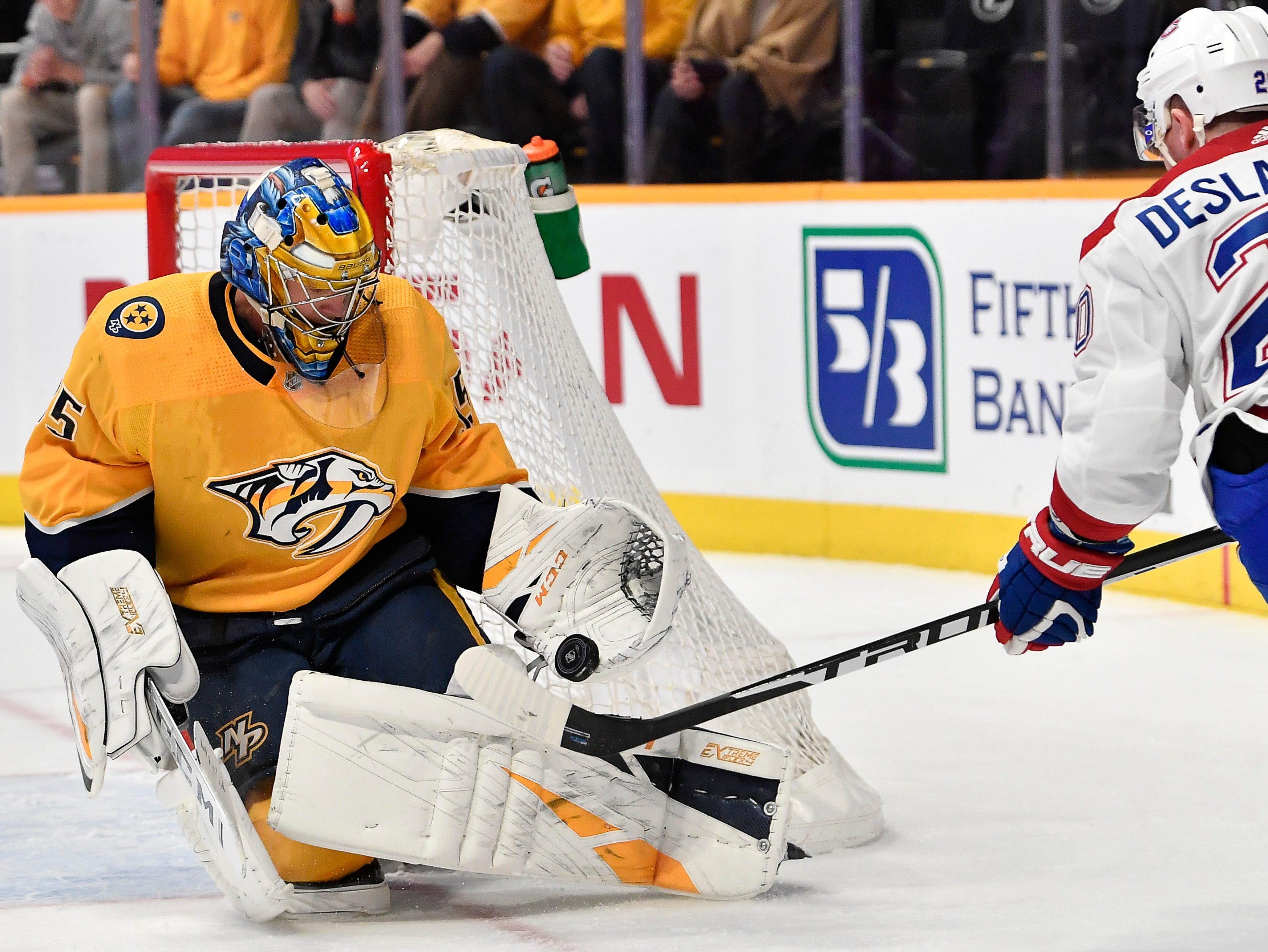 Predators goaltender Pekka Rinne (35) defends the goal against Canadiens center Phillip Danault (24) during the second period at Bridgestone Arena Thursday, Feb. 14, 2019 in Nashville, Tenn.