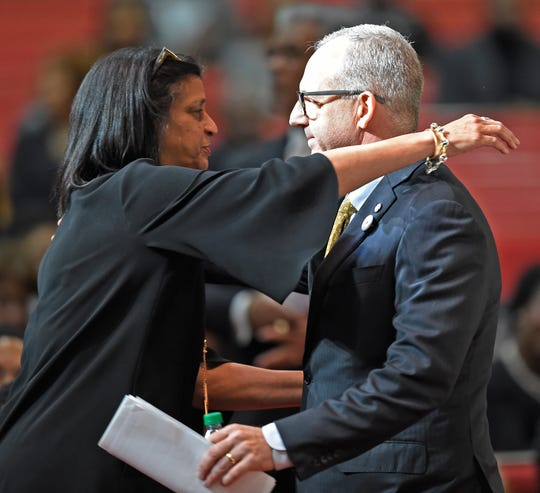 Gail Williams, widow of former Vanderbilt athletics director David Williams, hugs SEC Commissioner Greg Sankey, at the funeral for WIlliams Friday, Feb. 15, 2019, at The Temple Church in Nashville, Tenn.