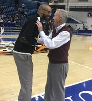 "Tennessee State coach Brian ""Penny"" Collins, left, and Belmont coach Rick Byrd talk at last night's OVC match-up at Gentry Center."