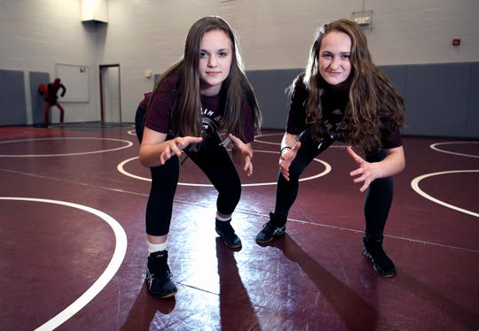 Isabella Campbell, left, and Annalise Dodson are the first girls to wrestle for Franklin High School.