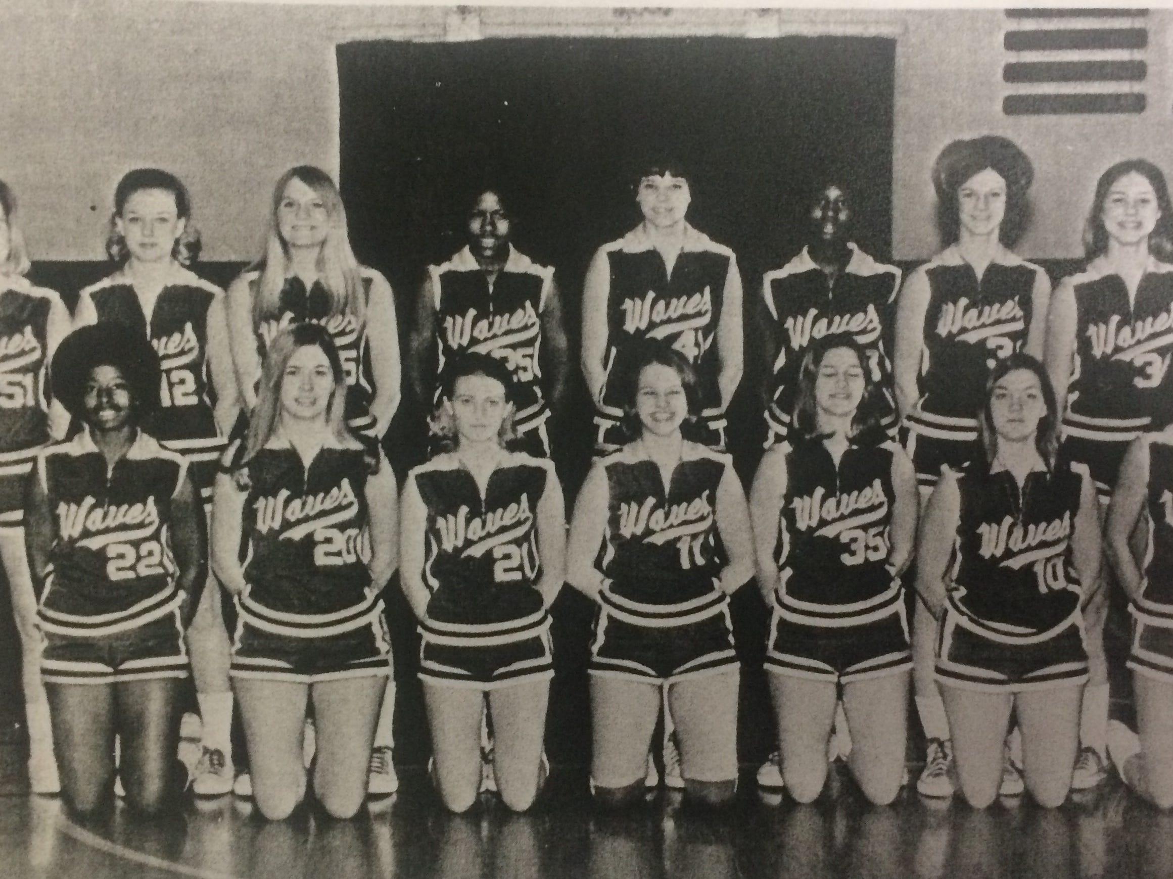 Gallatin High School 1970-71 girl's basketball team. Kneeling (L-R): Sylvia Bass, Pat Ridings, Kim Grizzle, Ruthie Langford, Susan Snyder, Sharon Snyder, Millie Parrish. Standing (L-R): Leila Jones, Clydell Parker, Debra Hall, Eula Cartwright, Leslie Campbell, Deloris Ligon, Connie Woodard, Suzanne Boze.