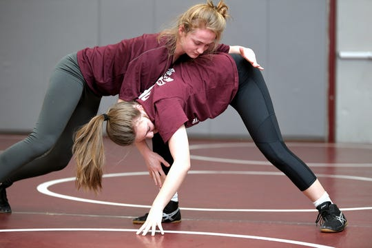Annalise Dodson and Isabella Campbell practice in the Franklin High School gym on Feb. 13. They are the first girls wrestlers to compete for FHS.