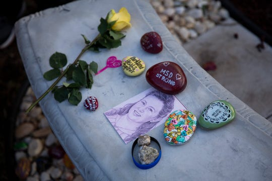 A drawing of Cara Laughran, who was one of the 17 people killed during the mass shooting last year at Marjory Stoneman Douglas High School in Parkland, is displayed in a memorial garden on Thursday.