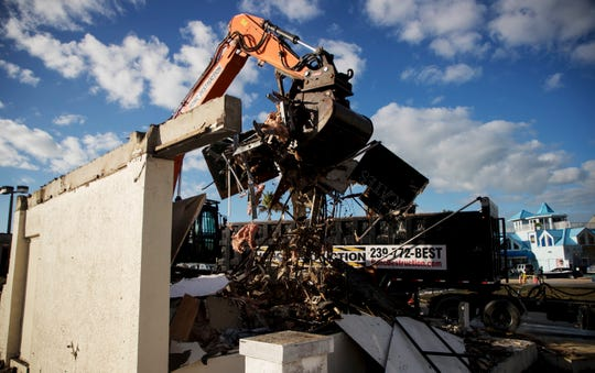 A crew from Honc Deconstruction demolished another building at the base of Matanzas Bridge on Fort Myers beach Friday 2/15/2019. The long vacant building, which used to house a tattoo parlor, is being knocked down to make room for the Margaritaville resort being built by TPI Hospitality.
