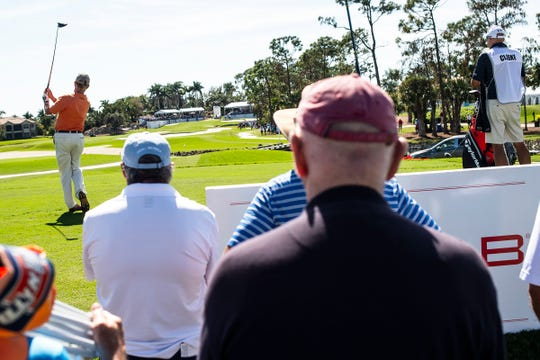 Spectators watch as Miguel Angel Jimenez tees off during the first round of the Chubb Classic in The Classics at Lely Resort on Friday.