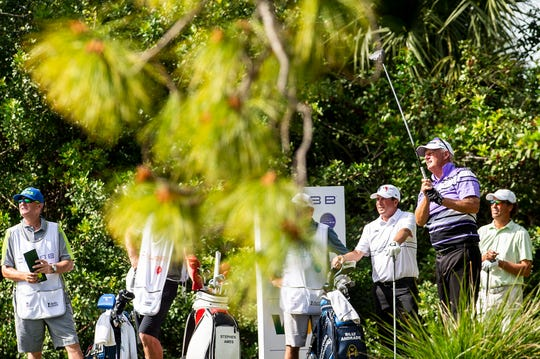 Sandy Lyle watches after teeing off from the 9th hole during the first round of the Chubb Classic in The Classics at Lely Resort on Friday.