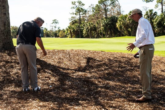 Darren Clarke takes a drop as an official talks with him about a new rule during the first round of the Chubb Classic at The Classics at Lely Resort on Friday. Taking a drop from the knee is one of several rules changes implemented for 2019.