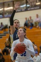 Barron Collier's Halie Egan attempts a shot against Lehigh during the Class 7A regional girls basketball quarterfinal on Thursday at Barron Collier High School.