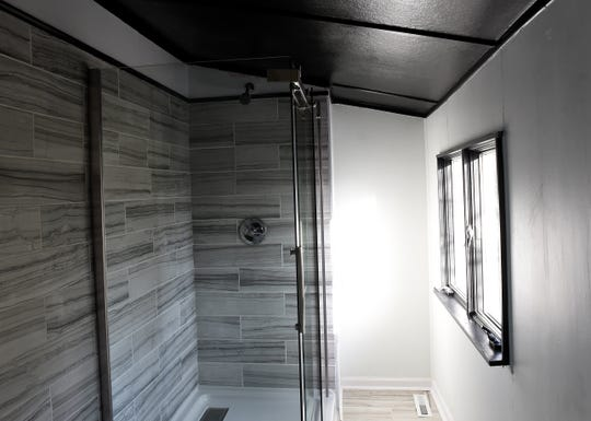 A walk-in shower in one of the upstairs bathrooms of one of Revival Homes' restoration homes on Granville Street in Newark.