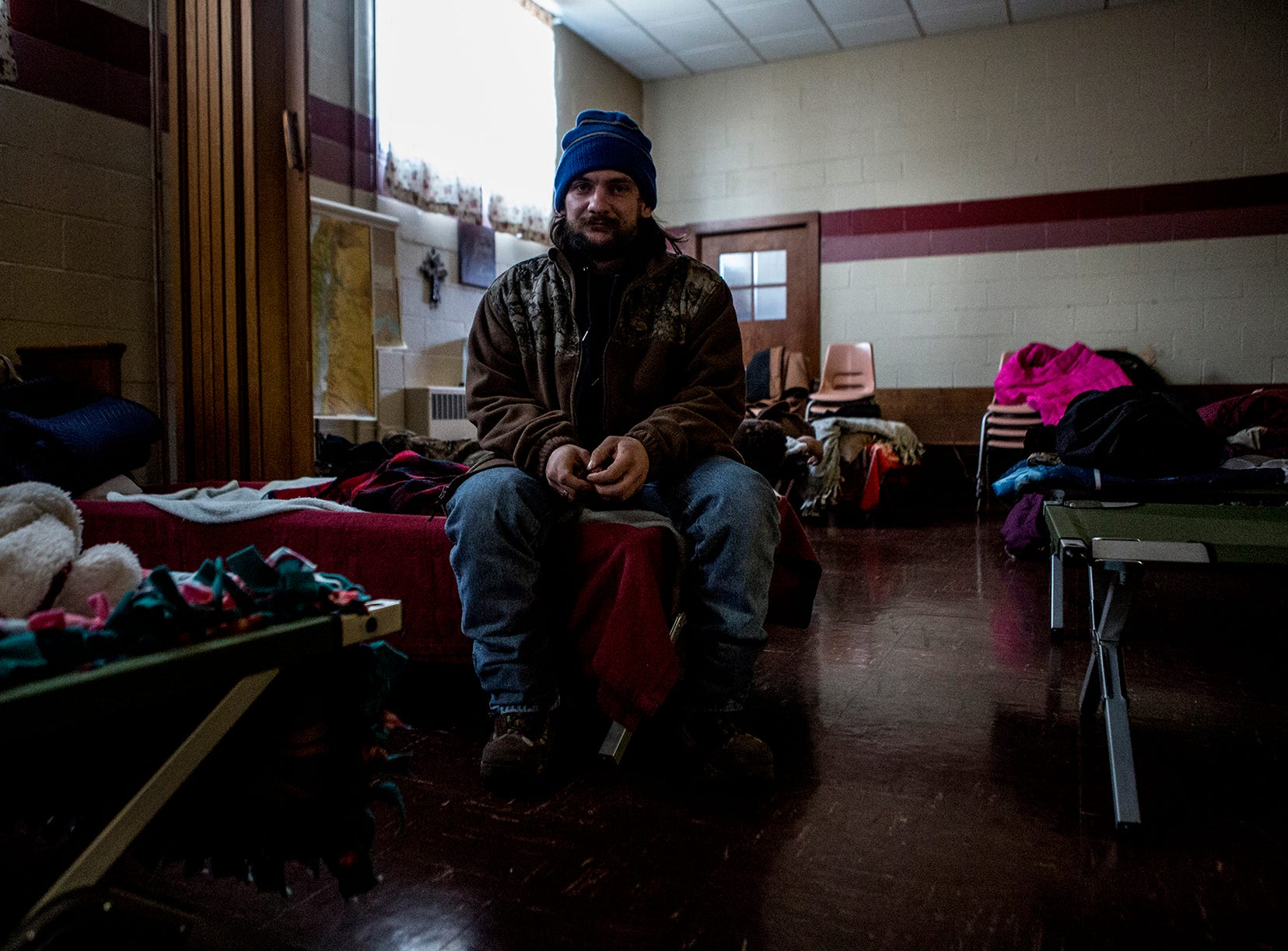 "Nick Eddy, 32, said he has been homeless off and on for three years. He lost custody of his kids, split from his wife and lost his drive for anything. He remains completely out of contact with his kids.  Nick was staying at the warming shelter at Central Christian Church when temperatures dropped below zero. He said the shelters were a blessing, as people could die, frozen to the ground and no one would know if they were dead or alive.  ""A lot of people think that us homeless that are out there, that we're lazy. That we don't want to go to work. I worked harder being homeless than any job. And I've been a mason and worked construction. It's a lot harder out here on the streets than in any other job."""