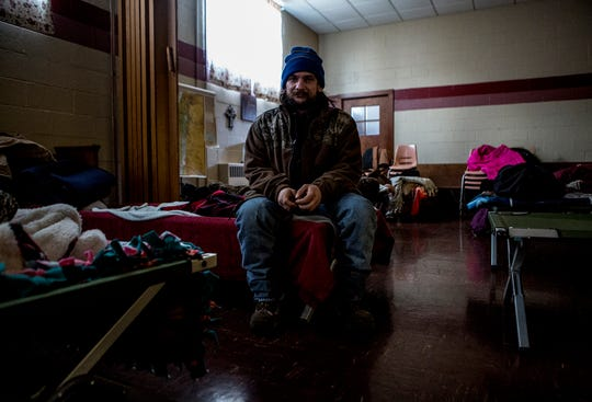 """Nick Eddy, 32, said he has been homeless off and on for three years. He lost custody of his kids, split from his wife and lost his drive for anything. He remains completely out of contact with his kids.  Nick was staying at the warming shelter at Central Christian Church when temperatures dropped below zero. He said the shelters were a blessing, as people could die, frozen to the ground and no one would know if they were dead or alive.  """"A lot of people think that us homeless that are out there, that we're lazy. That we don't want to go to work. I worked harder being homeless than any job. And I've been a mason and worked construction. It's a lot harder out here on the streets than in any other job."""""""