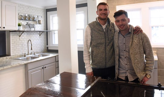 "Christopher Walisiak and James Carpenter in the kitchen of a renovated home on Granville Street in Newark. The two launched Revival Homes together and buy properties, rehabilitate and improve them, then ""flip"" them for profit."