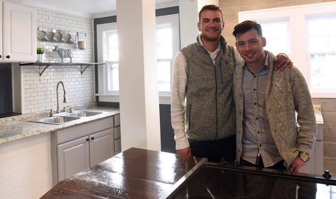 """Christopher Walisiak and James Carpenter in the kitchen of a renovated home on Granville Street in Newark. The two launched Revival Homes together and buy properties, rehabilitate and improve them, then """"flip"""" them for profit."""