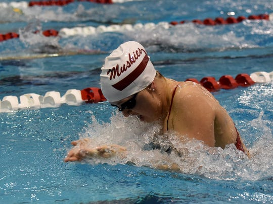 John Glenn's Tara Curtis competes in the 100 breaststroke during Thursday's Division II district swimming meet at Ohio State University's McCorkle Aquatic Pavilion.