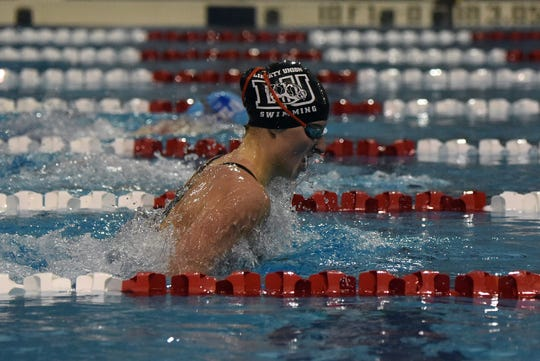 Liberty Union junior Logan Lawhorn swims the 100 breaststroke during the Division II district swimming championships. Lawhorn, a two-time defending state champion in the event, will compete in the state tournament on Thursday and Friday.