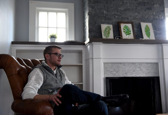 Christopher Walisiak talks about addiction and recovery in the living room of one of Revival Homes restoration homes on Granville Street in Newark.