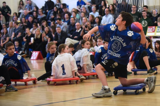 Wyckoff celebrates 25 years of Scooter Bowl, its indoor winter sport for fourth and fifth graders at Lincoln School in Wyckoff on Friday February 15, 2019. Petey, the Captain of the Giants, throws the ball.