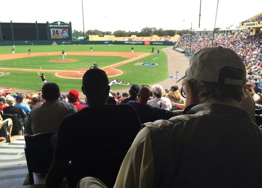 """In this March 5, 2016, file photo, Tommy Giordano, right foreground, special assistant to the general manager of the Atlanta Braves, scouts a spring training baseball game between the Braves and the Pittsburgh Pirates, in Kissimmee, Fla.""""I can't wait to get up in the morning and go to the ballpark,"""" he said in a 2016 interview. Giordano died Thursday, Feb. 14, 2019 at age 93."""