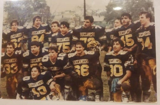 David Mozeika (back row, right, No. 34) with his teammates after his final high school football game Thanksgiving Day, 1983.