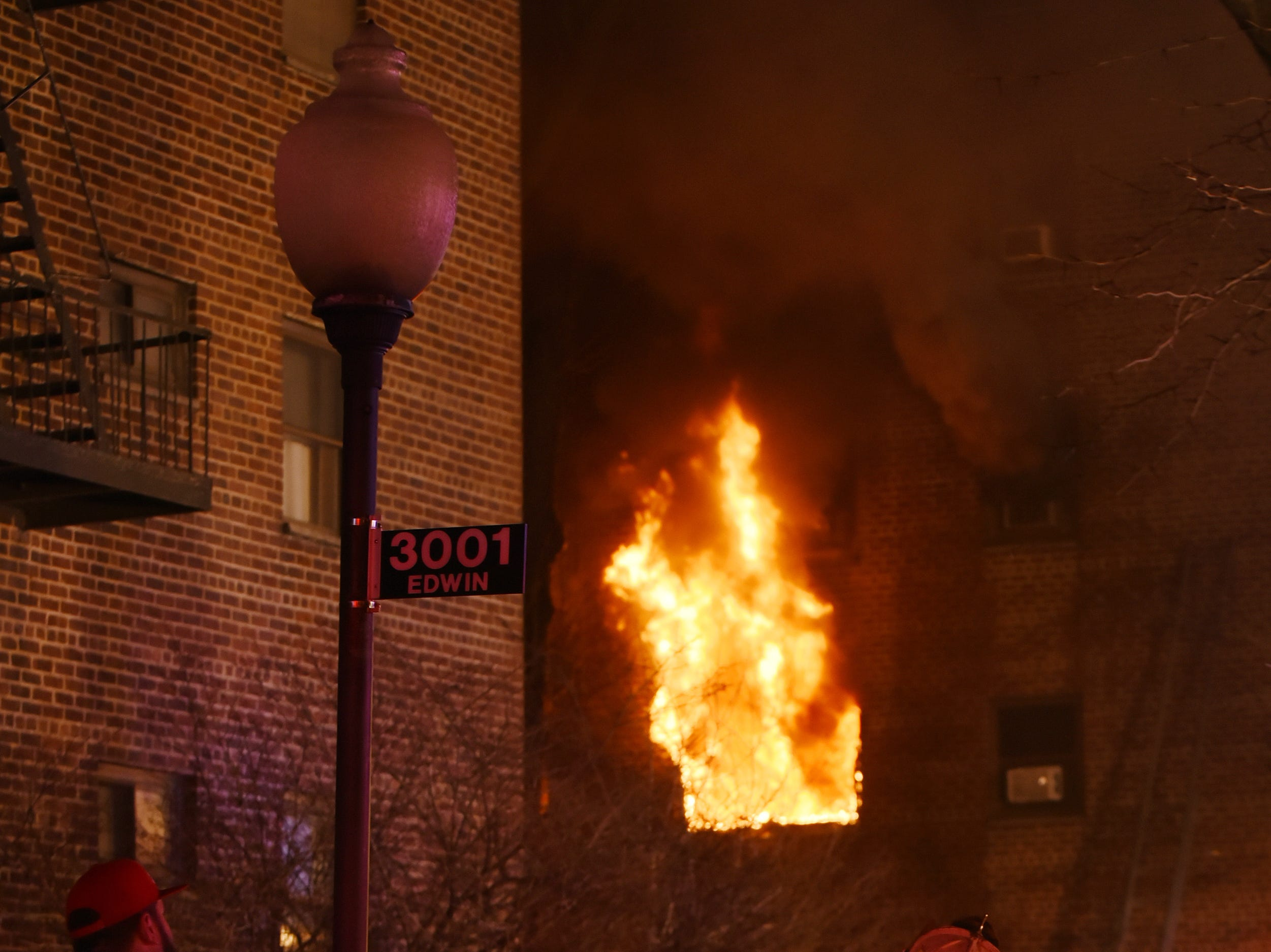 A small group watches as irefighters battle a blaze at the Linwood Apartments in Fort Lee on Thursday February 14, 2019.