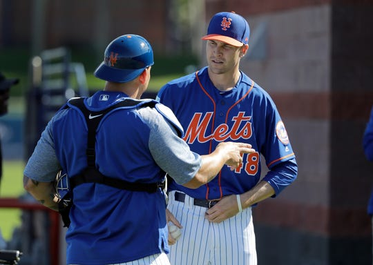 New York Mets pitcher Jacob deGrom, right, talks with catcher Wilson Ramos after throwing a bullpen session during spring training baseball practice Thursday, Feb. 14, 2019, in Port St. Lucie, Fla.