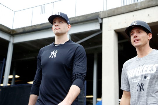 Feb 13, 2019; Tampa, FL, USA; New York Yankees starting pitcher James Paxton (left) and pitcher Danny Farquhar (right) come out to throw as pitchers and catchers report for spring training at George M. Steinbrenner Field.