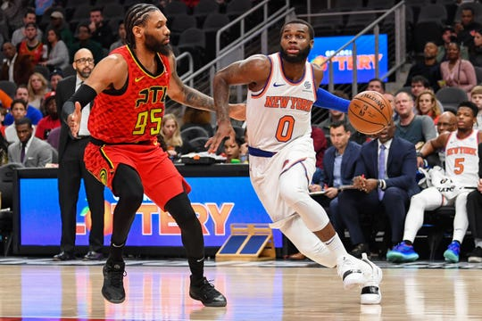 Feb 14, 2019; Atlanta, GA, USA; New York Knicks guard Kadeem Allen (0) dribbles against Atlanta Hawks forward DeAndre' Bembry (95) during the first half at State Farm Arena.