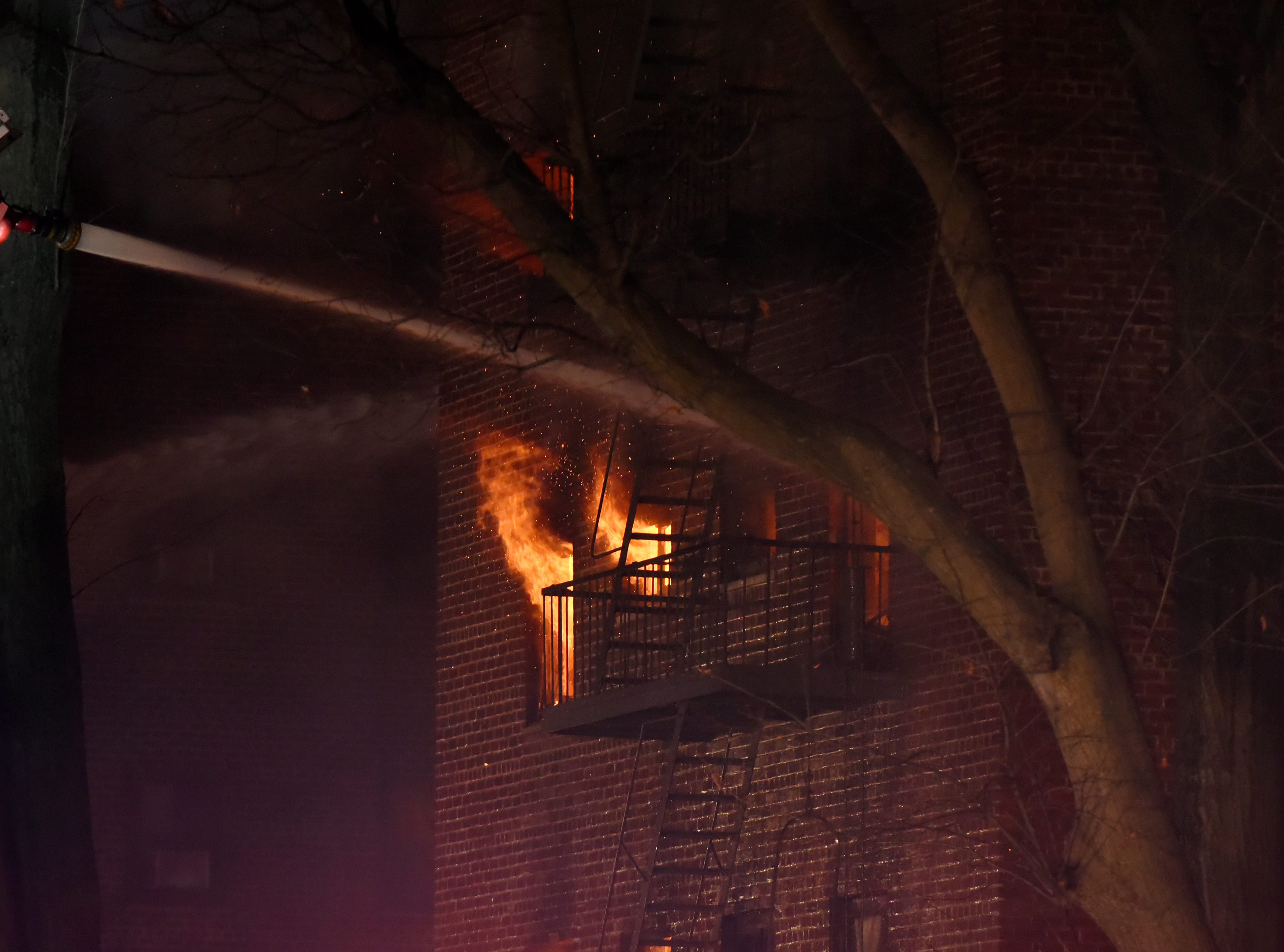 Firefighters battle a fire as it blazes at the Linwood Apartments in Fort Lee on Thursday February 14, 2019.