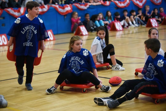 Wyckoff celebrates 25 years of Scooter Bowl, its indoor winter sport for fourth and fifth graders at Lincoln School in Wyckoff on Friday February 15, 2019. The Giants (blue) discuss strategy on the court.