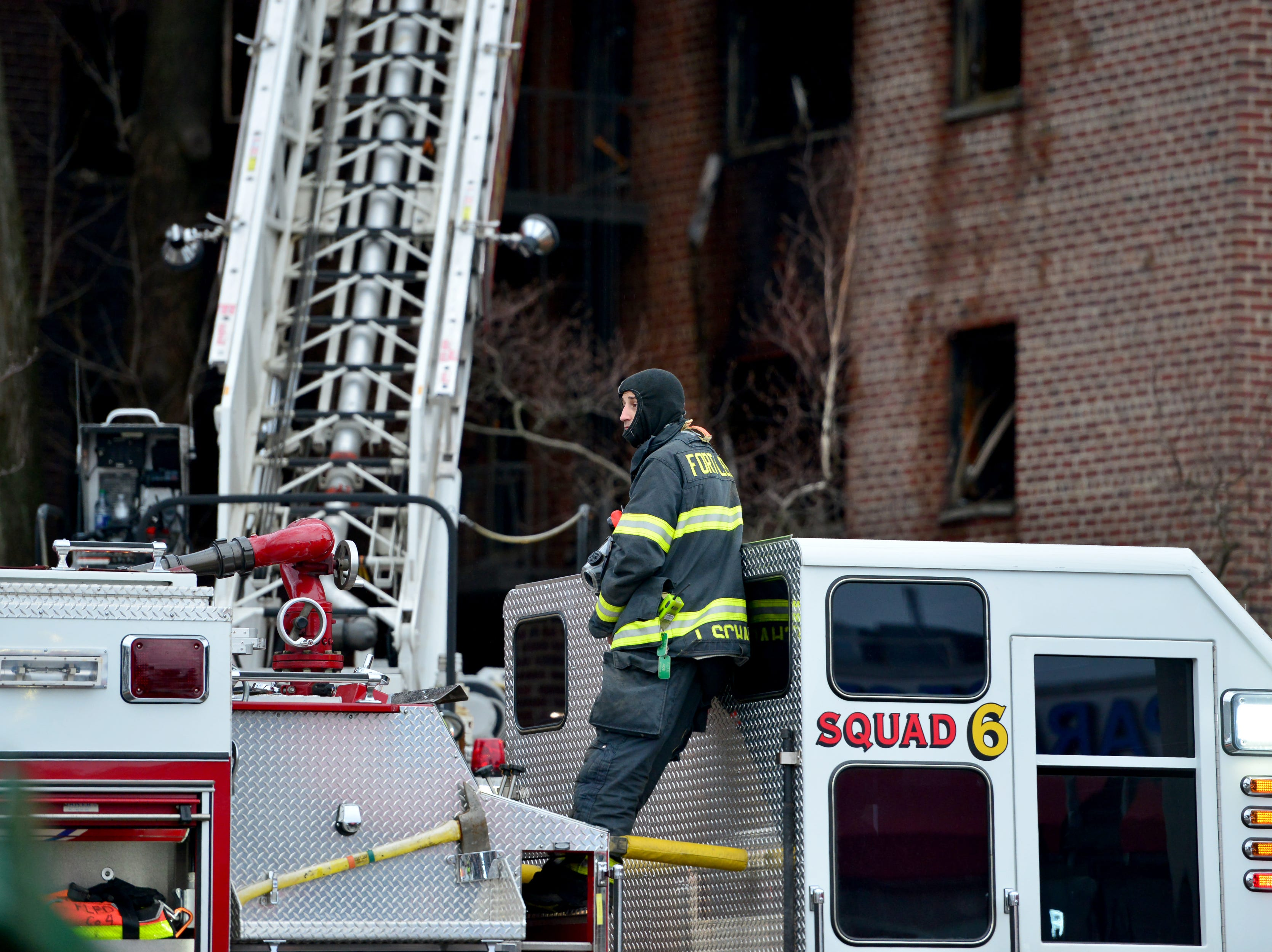Firefighters are hitting hot spots the morning after a fire broke out at an apartment complex on Edwin Ave in Fort Lee on Friday February 15, 2019.