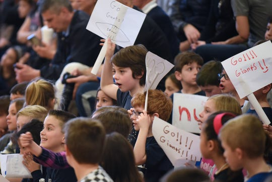 Wyckoff celebrates 25 years of Scooter Bowl, its indoor winter sport for fourth and fifth graders at Lincoln School in Wyckoff on Friday February 15, 2019. Students cheer for their teams from the sidelines.
