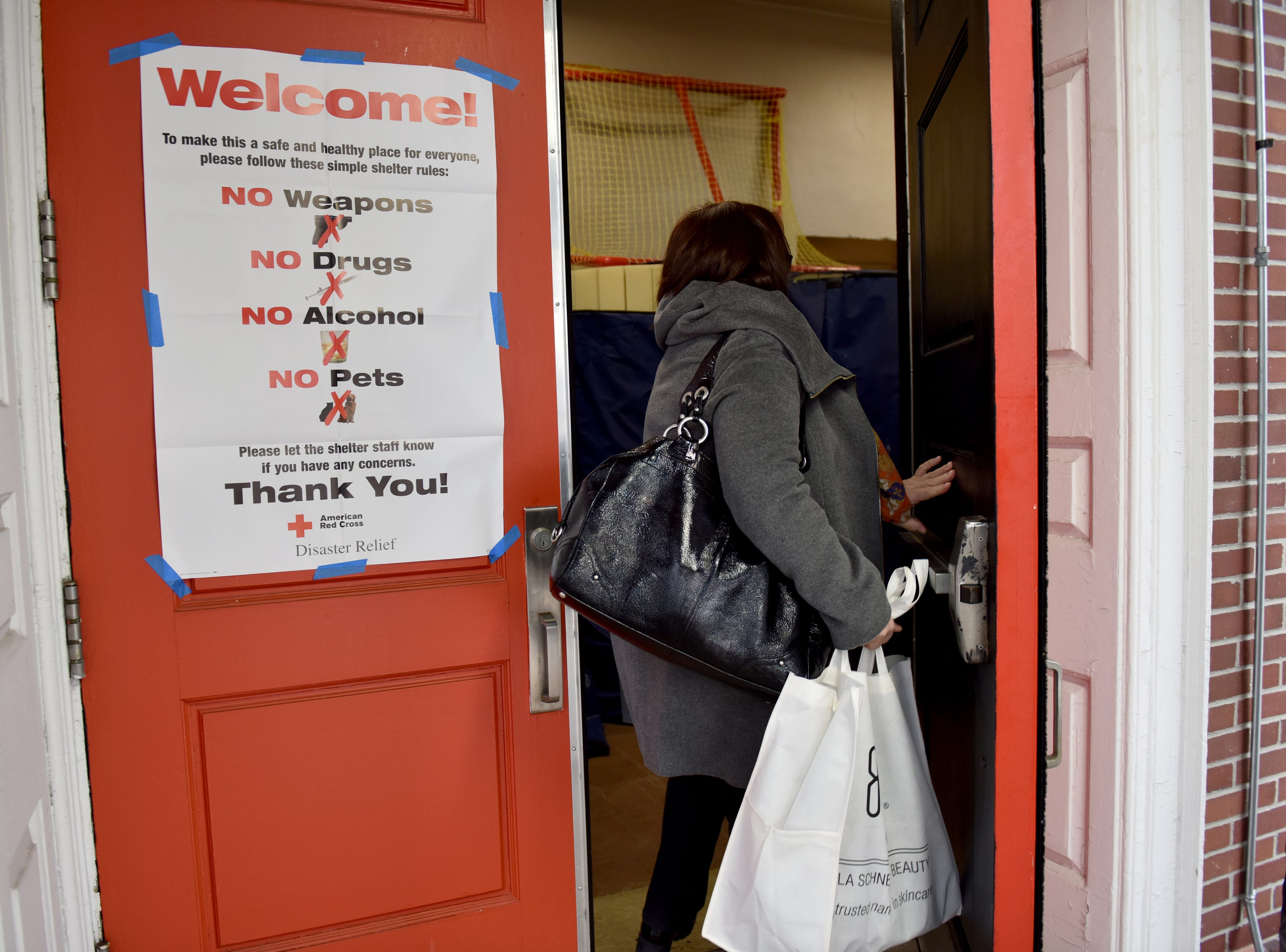 A woman is dropping off supplies to the Red Cross shelter which was set up at the Fort Lee High School gymnasium for residents that were displaced from the fire, which broke out at an apartment complex on Edwin Ave in Fort Lee.