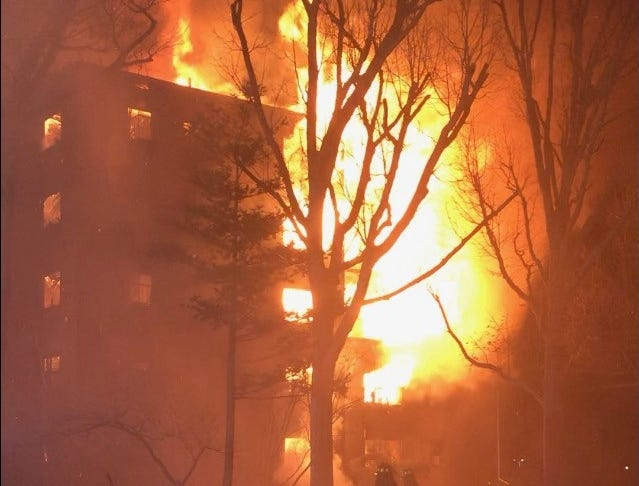 Fire burning out of control at an apartment building in Fort Lee Thursday night.