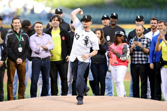 CHICAGO, IL - JUNE 01:  Danny Farquhar of the Chicago White Sox throws out a ceremonial first pitch before the game between the Milwaukee Brewers and Chicago White Sox at Guaranteed Rate Field on June 1, 2018 in Chicago, Illinois.