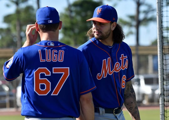 New York Mets relief pitcher Robert Gsellman (right) talks with Mets starting pitcher Seth Lugo (left) during spring training at First Data Field.