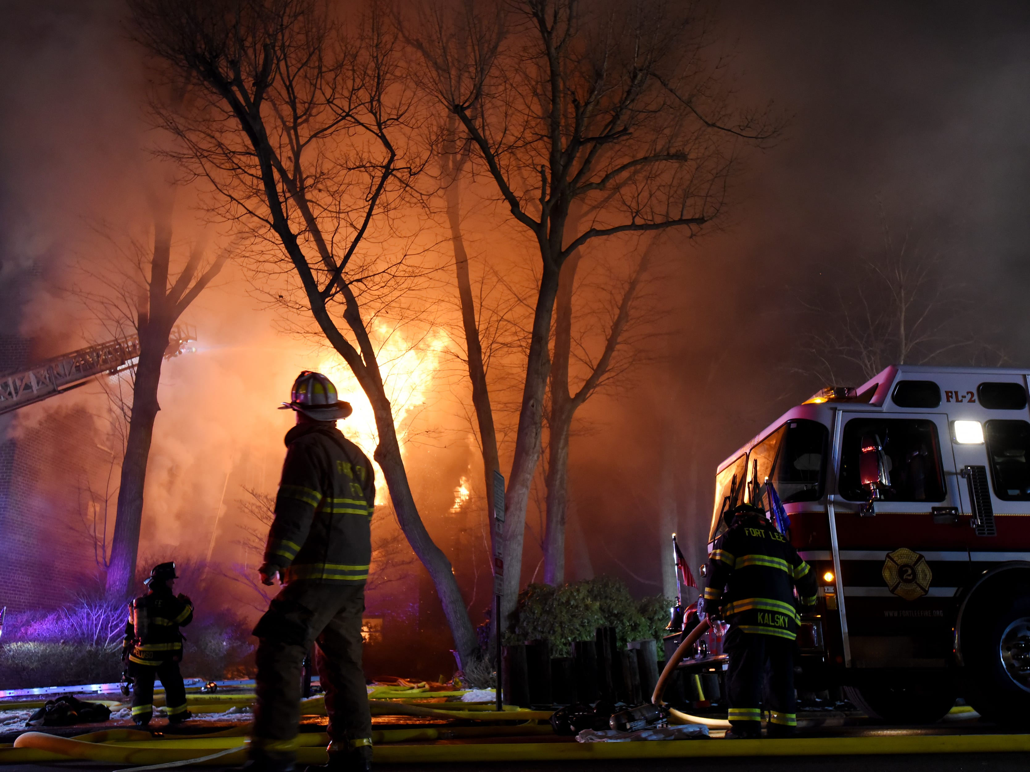 Firefighters battle a blaze at the Linwood Apartments in Fort Lee on Thursday February 14, 2019.