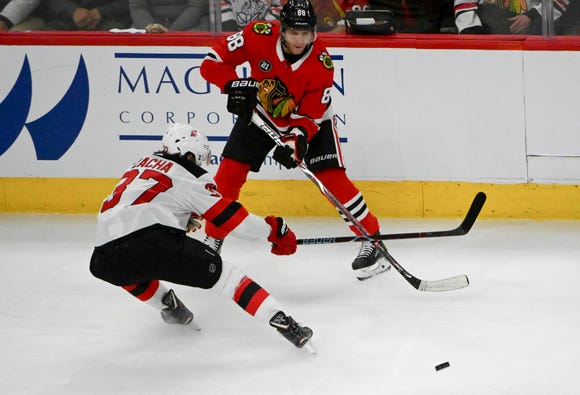 Feb 14, 2019; Chicago, IL, USA; Chicago Blackhawks right wing Patrick Kane (88) and New Jersey Devils center Pavel Zacha (37) fight for the puck in the first period at the United Center.