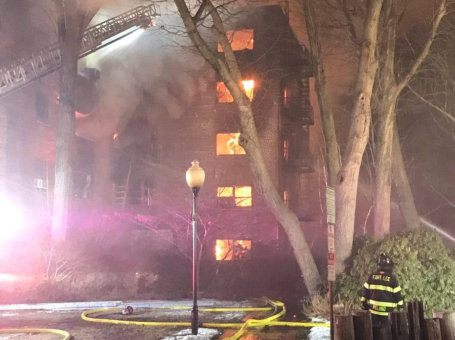 Fort Lee firefighters work on a fire within an apartment building on Edwin avenue in Fort Lee on Thursday, Feb. 14, 2019.