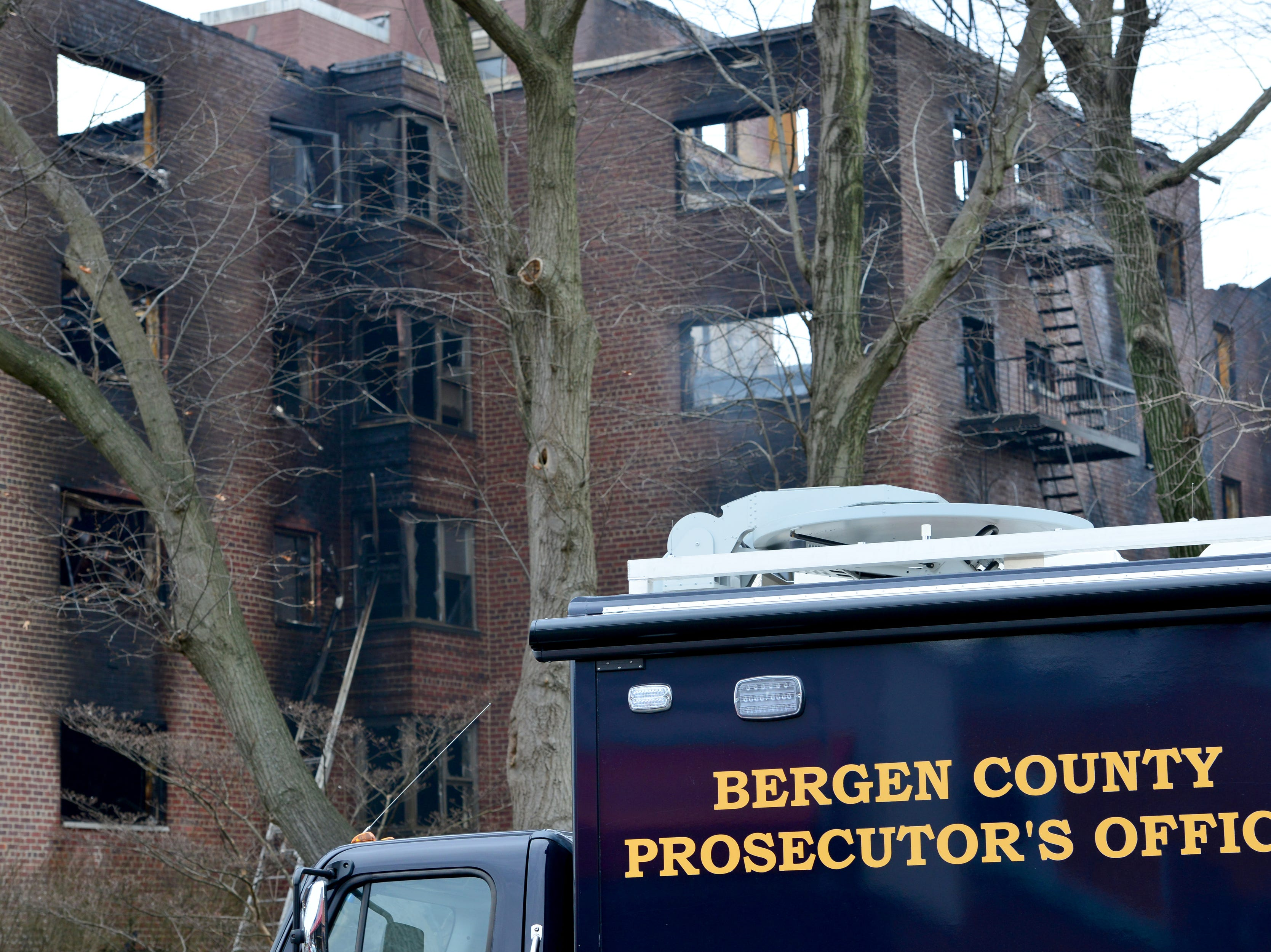 Bergen County Prosecutor's Office Arson Unit are at the scene of a multiple alarm fire that broke out at an apartment complex on Edwin Ave in Fort Lee.