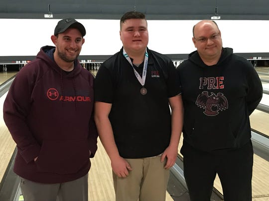 Park Ridge sophomore Joe Mahoney earned the silver medal at the NJSIAA individual boys bowling tournament on Friday, Feb. 15, 2019 at Bowlero North Brunswick after bowing to champion Joe Ocello of Neptune in the final, 229-224. From left: Park Ridge assistant coach Mike Wuhrman, Mahoney, head coach Blair Buscareno.