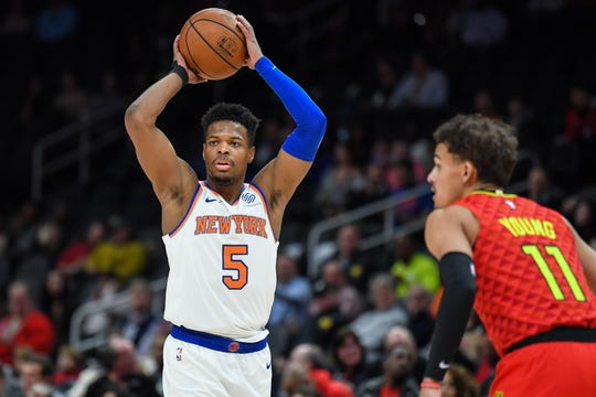 Feb 14, 2019; Atlanta, GA, USA; New York Knicks guard Dennis Smith Jr. (5) looks to pass against Atlanta Hawks guard Trae Young (11) during the first half at State Farm Arena.