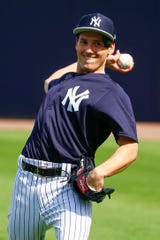 Feb 15, 2019; Tampa, FL, USA; New York Yankees pitcher Danny Farquhar (36) throws during spring training at George M. Steinbrenner Field.
