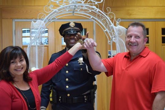 Teri and Scott Bannister renewed their vows at the Doña Ana County Government Center Feb. 14, and sealed their commitment with a pair of handcuffs, on loan from Doña Ana County Sheriff's Deputy Jamar Cotton.